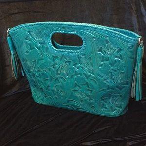 Leather hand tooled handbag